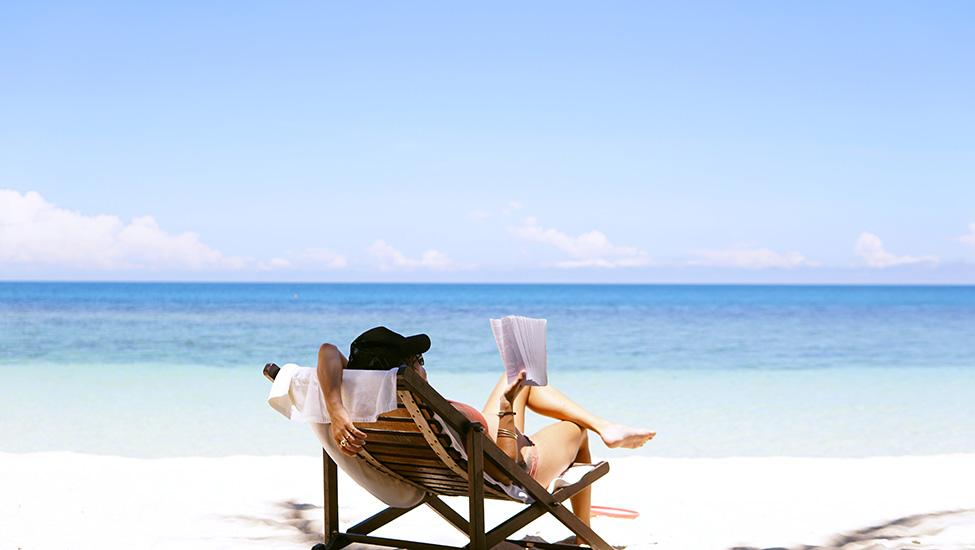 Women reading on the beach