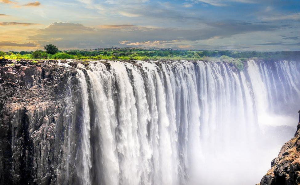 Rainbow appears over titanic Victoria Falls