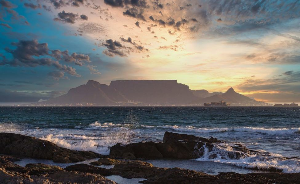 Beach with the view of Table Mountain in sunset
