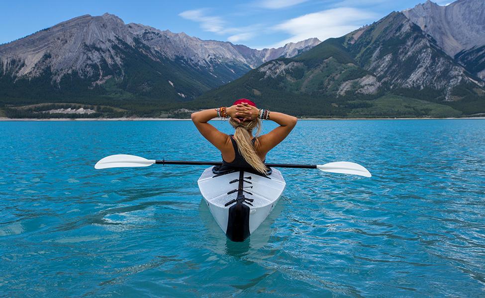 the girl enjoys kayaking