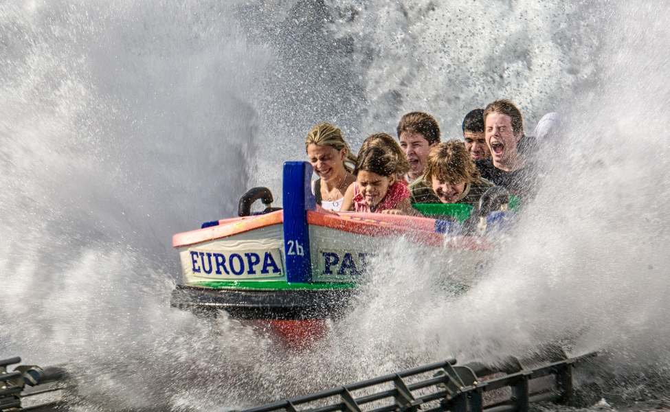 A family sliding through the water on a rollercoaster in Europa-Park, Rust