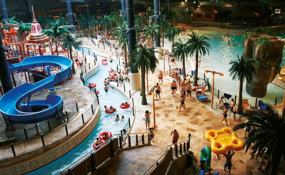 Pools, slides, and a meandering lazy river in the indoor water park Lalandia, Denmark