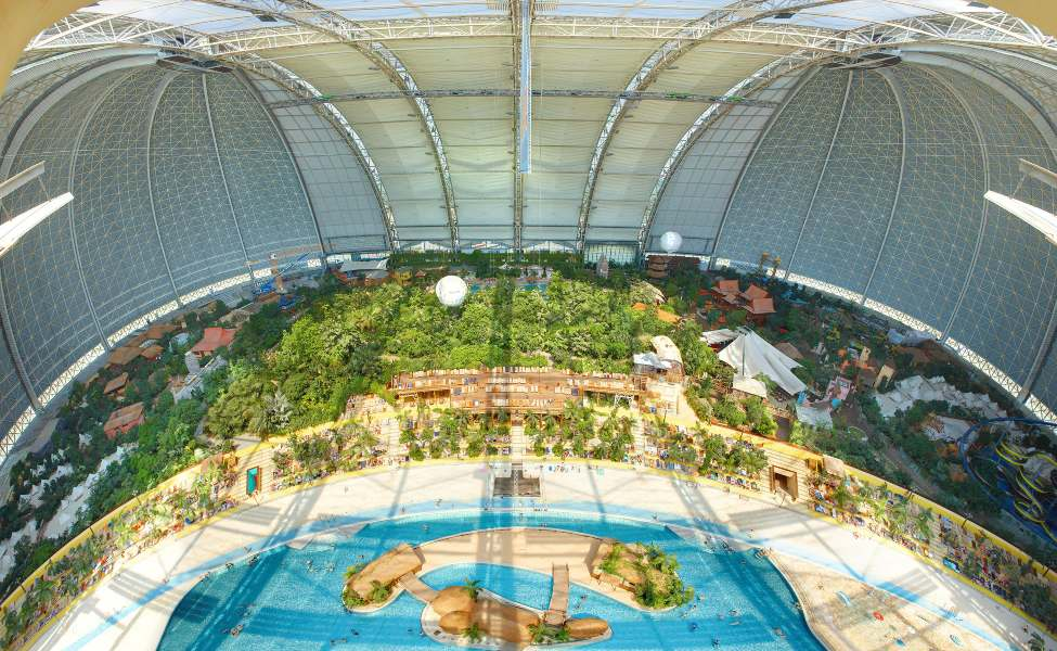 Aerial view of the tropical resort under the dome of the former airship hangar