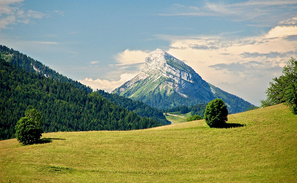 Mountain with green land around it