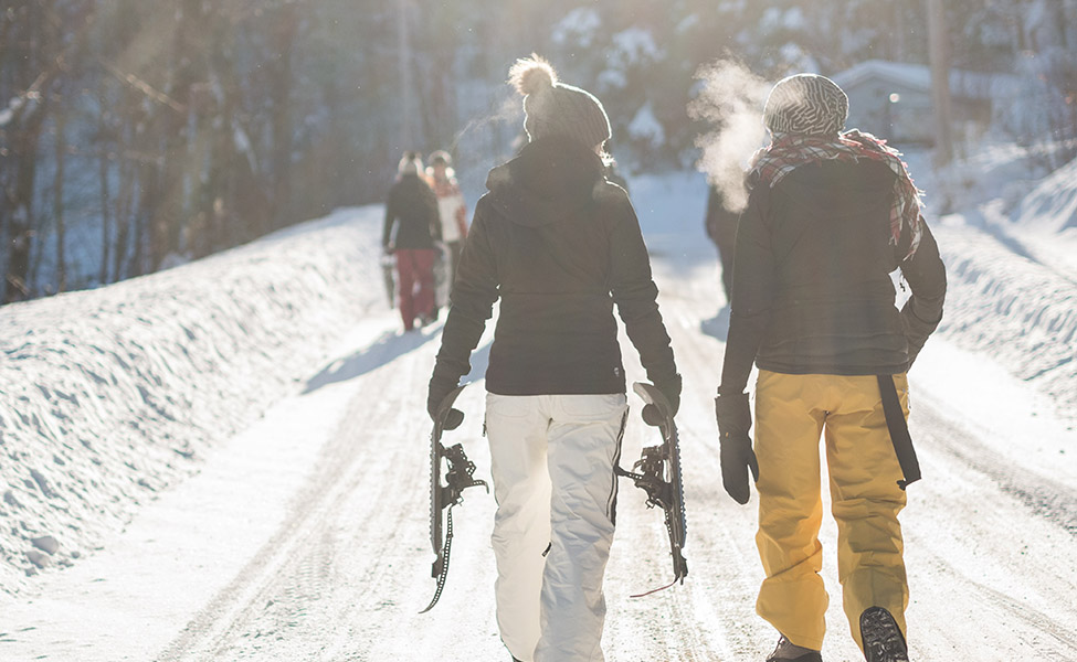 A girl and a boy go to ski on the French Alps