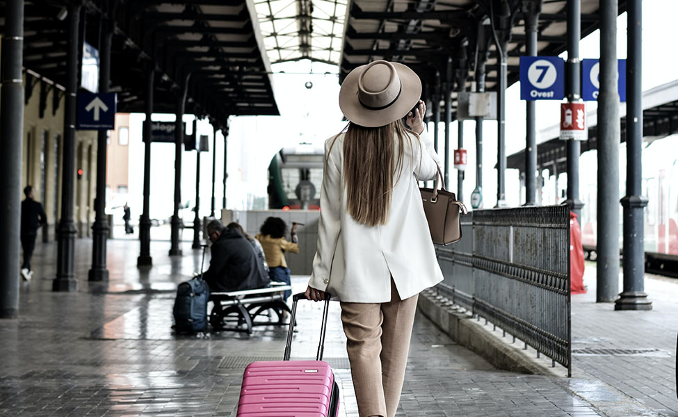 a girl with a suitcase is traveling somewhere
