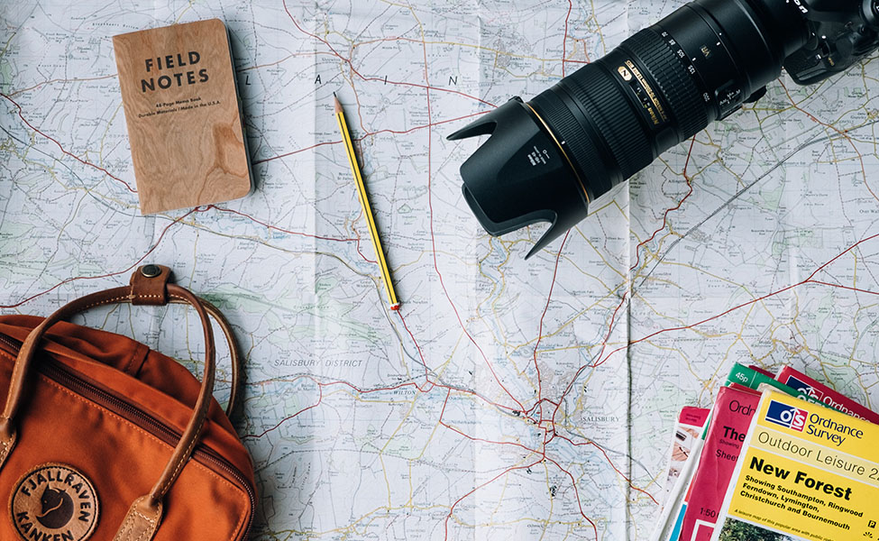 camera and map, everything you need for travel