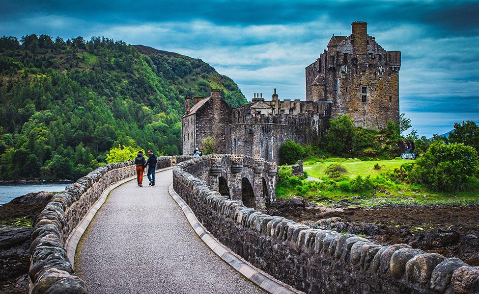 A couple walking towards castle