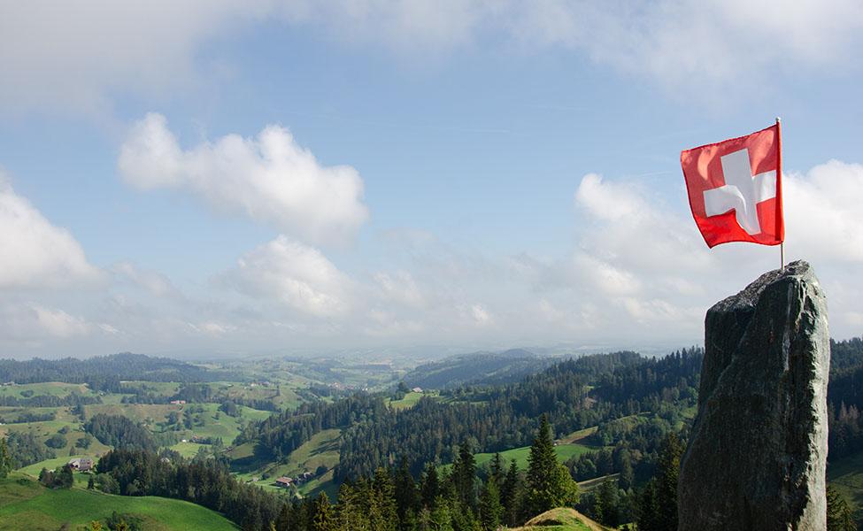 Switzerland flag and majestic Alps