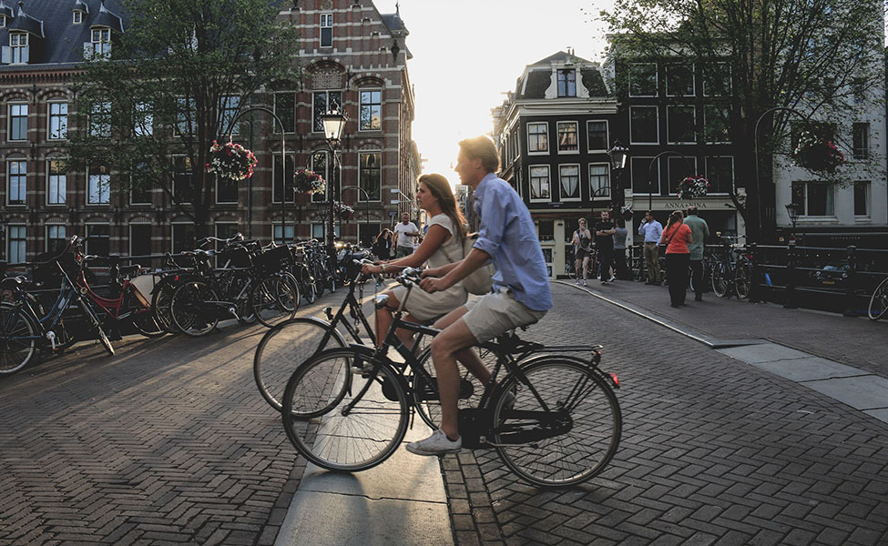 People ride a bike in Amsterdam
